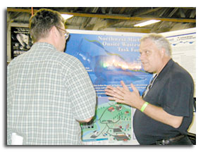 Onsite Treasurer and Grand Traverse County Planner John Sych talks with Dr. Raymond Ehrhard on right.
